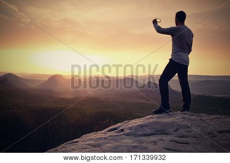 Tourist Hold Shinning Phone And Phototograph Spring Land