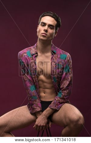 Young Handsome Man Posing, Purple Color