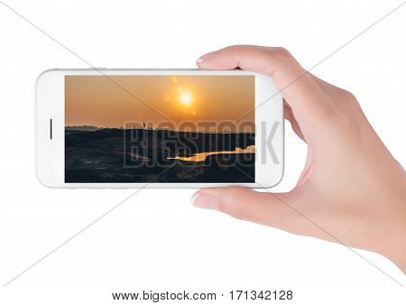 Woman using her smart phone searching Beautiful Sunrise information A shadow of runner pass through sun and dry land with flare light Effect. Traveling concept isolated on white background.