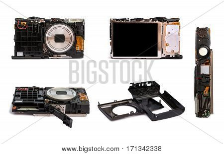 Disassembled digital camera from different angles. Details of the broken camera isolated on white background.Repair of photographic technique.