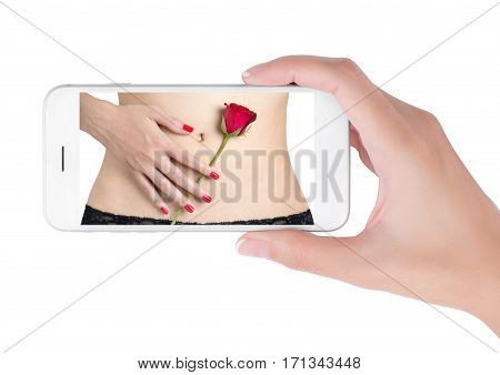 Woman using her smart phone searching hand red nails holding red rose on sexy belly. valentine and sexual concept Isolated on white background.