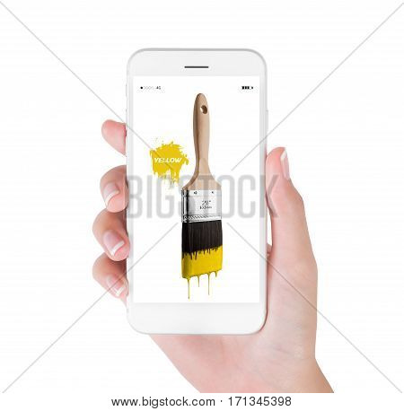 Woman using smart phone searching paintbrush loaded yellow color dripping off bristles. Art and Design concept isolated white background.