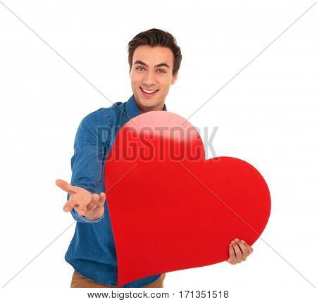 smiling young casual man inviting you to love him on white background