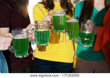 Friends with beer celebrating Saint Patrick's Day in pub