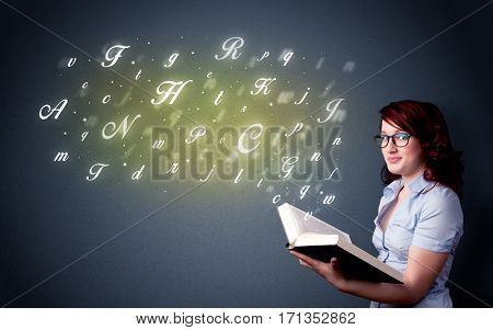 Casual young woman holding book with shiny letters flying out of it