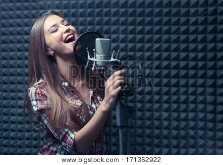Young singer in a recording studio