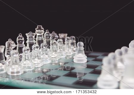 Chess Of Glass On A Black Background, The Beginning Of The Game.
