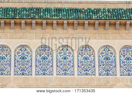 Beautiful arcade in oriental style decorated with floral ornaments in Monastir, Tunisia poster