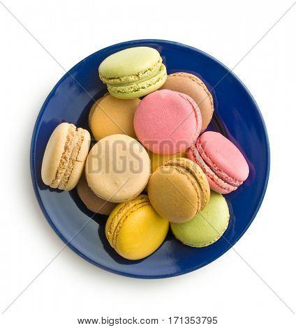 Tasty sweet macarons. Macaroons on plate. Top view.