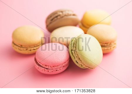 Tasty sweet macarons. Macaroons on pink background.