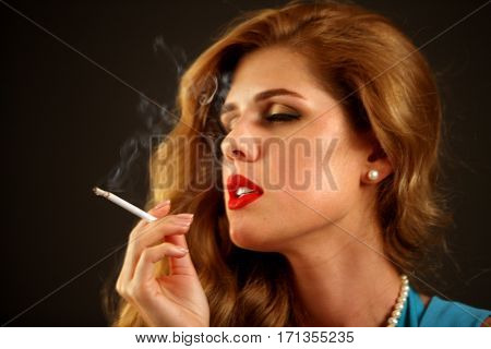 Woman smokes marijuana. Girl who smokes cigarette. Smoke is bad habit. Nicotinic acid is harmful to health and female beauty. Female dreems quit smoking.