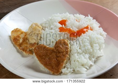 Idea for Valentine day meal cooked rice omelet in heart shape for eating simple cheap and quick food