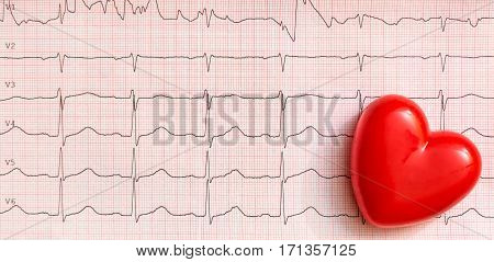 Red Heart on cardiogram. Medical concept .