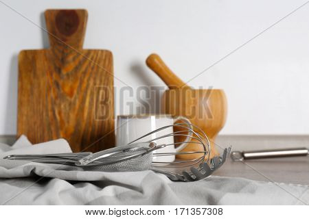 Different cooking utensils on kitchen table