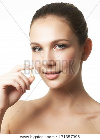Portrait Of Woman With Omega 3 Fish Oil Capsule, Outdoors. Food Supplement
