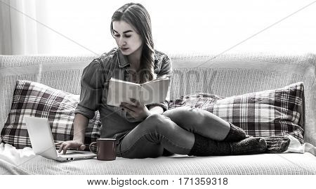 Girl Cozy With A Book And A Cup