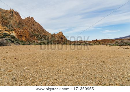 Volcanic landscape with erosion and sparse vegetation. Tenerife Canary islands Spain