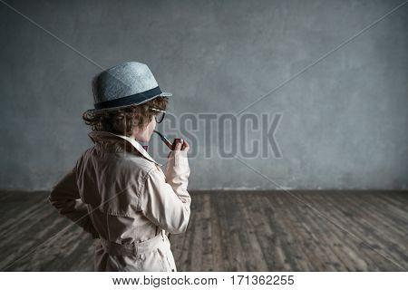Thinking little detective in studio
