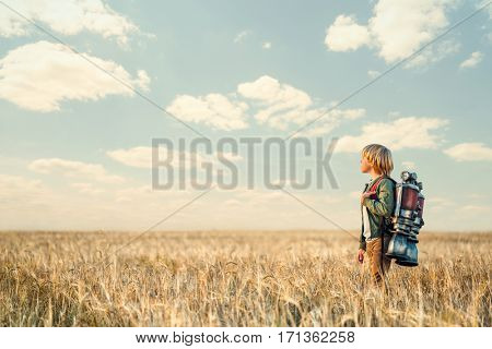 Little boy with a backpack outdoors