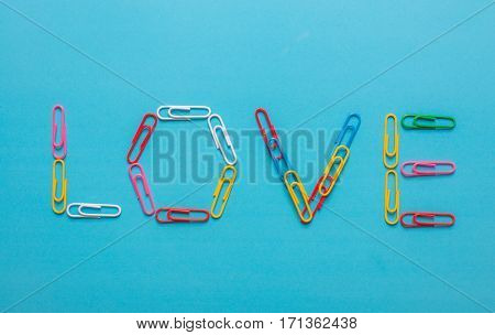 Colorful paper clips forming the word
