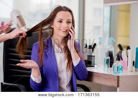 Woman getting her hair done in beauty shop