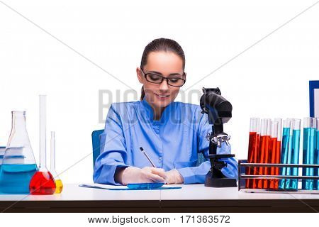 Young female doctor in lab isolated on white