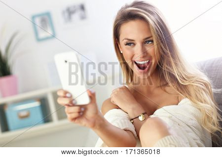 Picture showing happy woman taking selfie on sofa