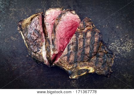 Barbecue dry aged Cote de Boeuf as close-up on a rusty metal sheet
