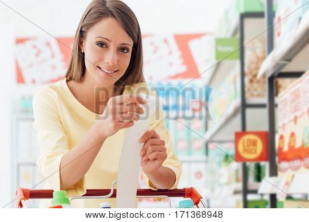 Woman Checking The Grocery Receipt