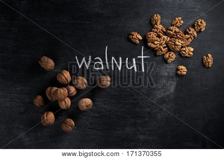 Top view picture of walnut over dark chalkboard background