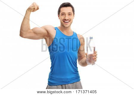 Happy young man holding a bottle of water and flexing his biceps isolated on white background