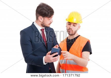 Young Director Showing Something To Constructor Or Engineer