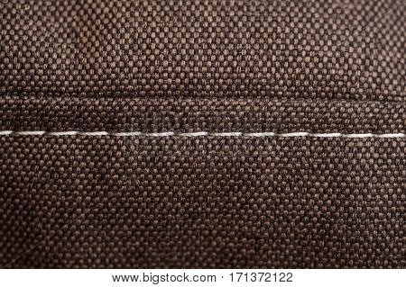 brown fabric texture with white seam for background
