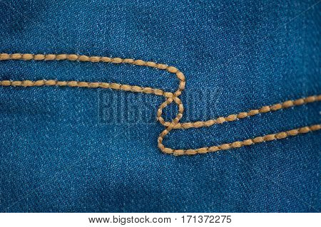 denim texture with brown seam for background