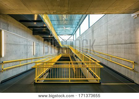 ramp way with yellow handrail for support wheelchair disabled people.