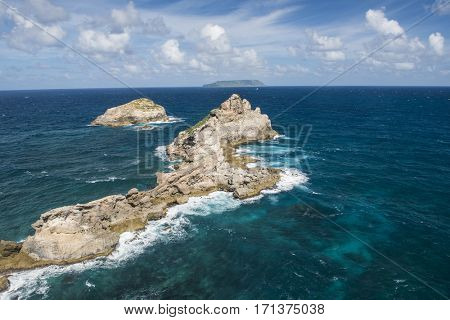 Rocks in the sea seen from the Pointe des Chateaux, the most Eastern point of French island  of Guadeloupe in the Caribbean