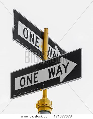a couple of isolated one way sign