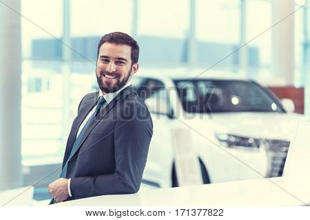 Young businessman in showroom
