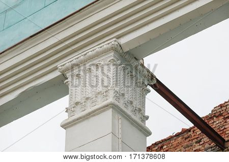architectural echinus of the column on the facade of a historic building