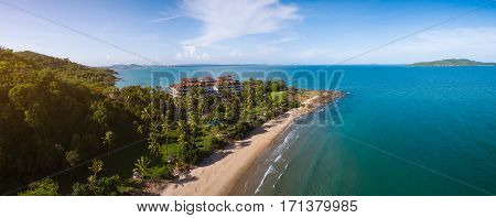 Scenery of the sea in Rayong Thailand. mountain sea in Thailand. panorama sea. Tropical beach with sea and palm taken from drone. Beach drone photo. Beach and sea photo. Beach and palms. White sand beach. Romantic beach aerial shot.