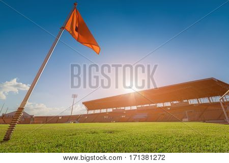 Green grass in soccer stadium on sunset. soccer stadium on sunset. soccer stadium concept. soccer stadium filed. soccer stadium vivid tone.