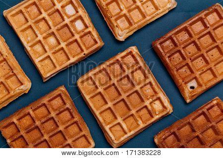 Belgian Waffles texture. Waffles on blue background