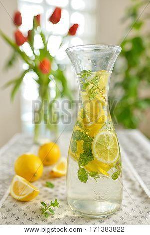 Fresh limes and lemonade on table, close up