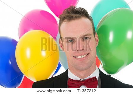 Portrait young man with a bunch of colorful balloons isolated over white background