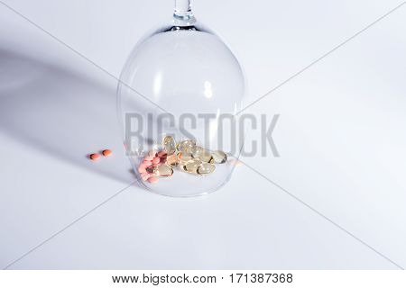 Capsule And Pills Inside Wineglass