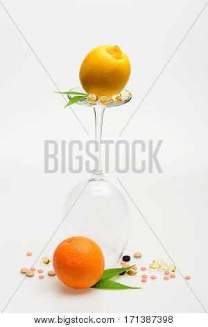Orange And Lemon, Wineglass With Pills And Capsule