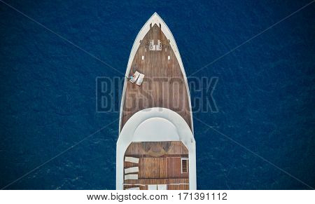 Aerial close-up view of big luxury yacht in sea, copyspace for text