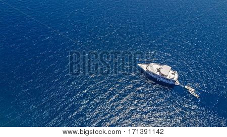 Aerial view of small boat in sea, copyspace for text