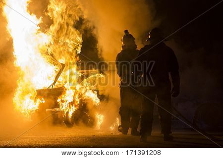 Burning car on the road in the night
