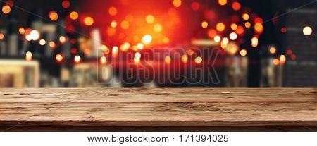 Panorama background for a pub at night in front of an empty wooden table